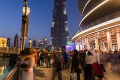 People watching Burj Khalifa from Dubai Mall fountain Stock Images