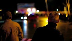 People Watching Car Drifting At Night stock video