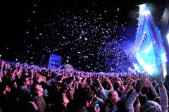 People watching a concert, while throwing confetti from the stage at Heineken Primavera Sound 2013 Festival Royalty Free Stock Photos