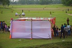 People watching cricket games around a village ground. Bangladeshi people gathered together to watch a cricket game in the village ground unique editorial photo stock photography