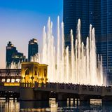 People Watching Dubai Fountains, Illuminated Trick Fountains At Night Stock Photography