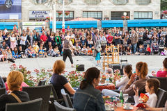 People watching entertainers in Zagreb, Croatia. Crowds of tourists and residents watching entertainers perform during 15th Cest is d'Best festival on main Ban stock photos