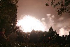 People watching a firework royalty free stock photo