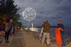People watching firework display in Muri lagoon Rarotonga Cook I Royalty Free Stock Photos