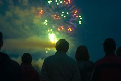 People Watching Fireworks Stock Photo