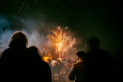 People watching fireworks Royalty Free Stock Image