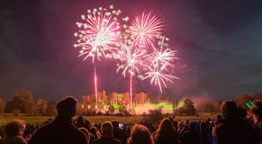 People watching Fireworks display at bonfire 4th of November celebration, Kenilworth Castle, united kingdom. Fireworks display at bonfire 4th of November Royalty Free Stock Photo