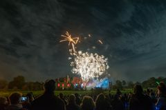 People watching Fireworks display at bonfire 4th of November celebration, Kenilworth Castle, united kingdom. Stock Photo