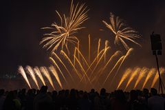 People watching fireworks in night sky royalty free stock images