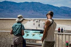 People watching a map near Death Valley royalty free stock image