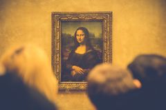 People Watching Mona Lisa Painting on Brown Painted Wall Stock Photos