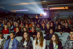 People watching a movie at the cinema of Bellinzona Stock Photography