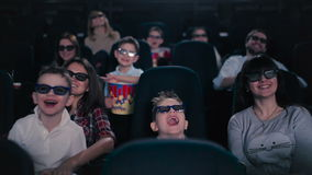 People are watching the movie in the cinema stock video footage