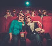 People watching movie in cinema. Group of people in 3D glasses watching movie in cinema royalty free stock photography