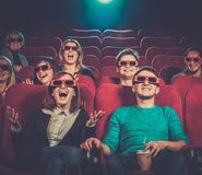 People watching movie in cinema. Group of people in 3D glasses watching movie in cinema royalty free stock photos