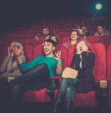 People watching movie in cinema. Group of young people watching movie in cinema royalty free stock images