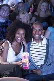 People Watching Movie In Theatre Stock Images
