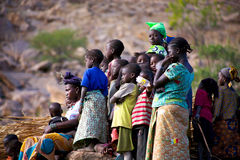 People watching music and dance in Dogon Land. MALI, DOGON LAND, DECEMBER 28: Unidentified Group of african people, kids, and women, watching a festival of music Stock Photo