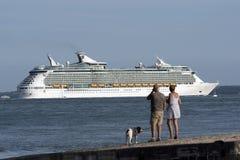 People watching Navigator of the Seas underway on Southampton Water UK Stock Photos