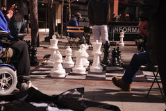 People watching others play urban chess Royalty Free Stock Image