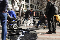 People watching others play urban chess. A group of people at Seattle's Westlake Park observing  a game of outdoor public chess Royalty Free Stock Images