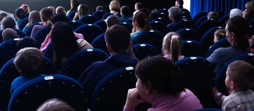 People watching the performance in the theatre royalty free stock images