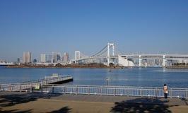 People watching the Rainbow bridge in Tokyo, Japan Royalty Free Stock Photo