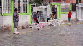 People watching the river created in the streets due the flood. C. Izcalli, State of Mexico 06/Sep/17. People watching the river created in the streets due the stock footage