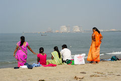 People watching the sea on the beach of Fort Cochin Stock Photos