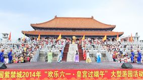 People watching show in front of pa. Xiamen, China - Jun 2, 2014: People watching show in front of palace Stock Photo