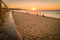 People watching the sunset at the beach in Frankston, Australia Royalty Free Stock Photography
