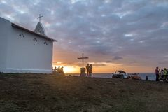 People watching the sunset at Chapel of Sao Pedro dos Pescadores - Fernando de Noronha, Pernambuco, Brazil royalty free stock photo