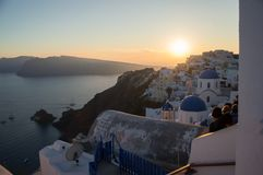 People Watching a Sunset with Sea View in Oia, Santorini, Cyclad royalty free stock image