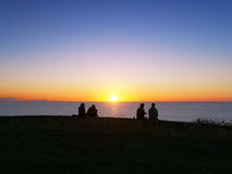 People watching the sunset in Sopelana Stock Photography