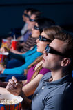 People watching three-dimensional movie. Royalty Free Stock Photography