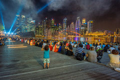 People are watching water show at Singapore Royalty Free Stock Photo