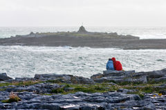 People watching the waves on Doolin beach, county Clare, Ireland. Windy day at Doolin`s Bay, The Burren, County Clare, Ireland Royalty Free Stock Images