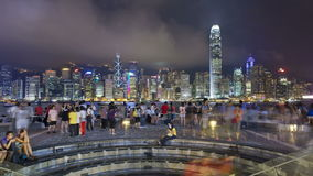 People watching the world famous sound and light show Hong Kong city skyline stock video footage