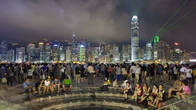 People watching the world famous sound and light show hong kong city skyline stock video