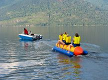 People on the water-banana Stock Photography