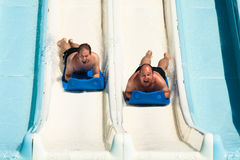 People at water park. People having fun, sliding at water park Stock Photos