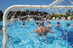 People water polo play in the pool, conceptual of a summer vacation and travel Royalty Free Stock Photo