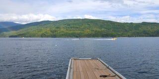 People Water Sking on the Mountain Lake Royalty Free Stock Image