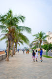 People on the waterfront  in Pondicherry, India Stock Image