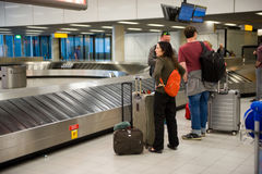 People wating for suitcase Royalty Free Stock Photography