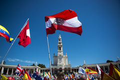 People waving flags from different countries at the Sanctuary of Fatima during the celebrations of the apparition of the Virgin Ma. Fatima, Portugal - May 13 Stock Images