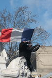 People waving french flag in Paris Royalty Free Stock Image