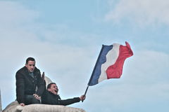 People waving french flag in Paris Stock Photos
