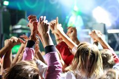 People waving hands at a concert.  Stock Photos
