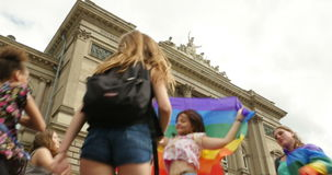 People waving rainbow flag at gay parade stock footage